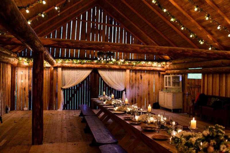 Bridebook.co.uk Rustic Barn Venue Candlelit Trestle Table Wedding Reception