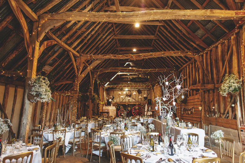 Bridebook.co.uk- rustic wedding venue decorated for wedding breakfast
