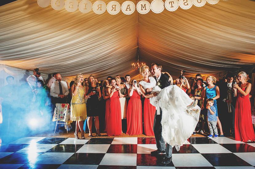 Bridebook.co.uk- groom lifts bride during first dance