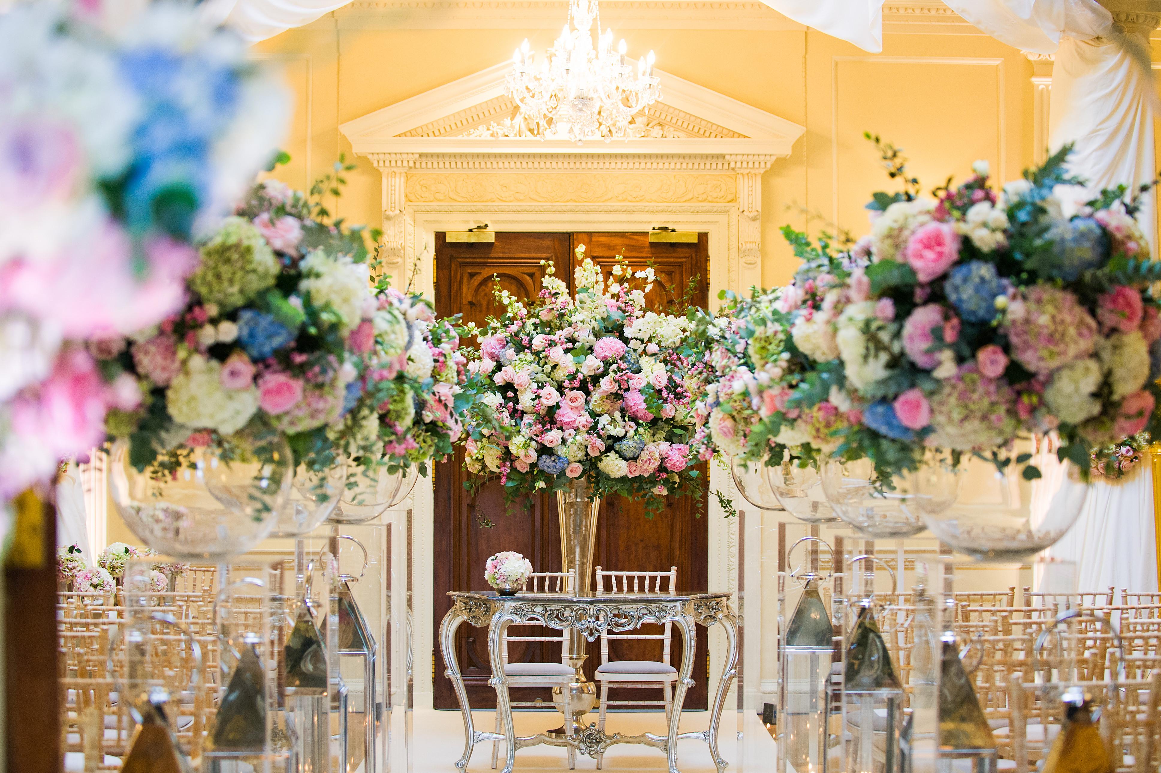 Bridebook.co.uk- Ceremony venue decorated with flowers