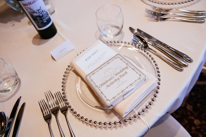 Bridebook.co.uk- table setting with childrens activity pack