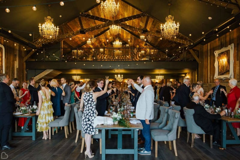 wedding guests toast inside wharfedale grange wedding venue