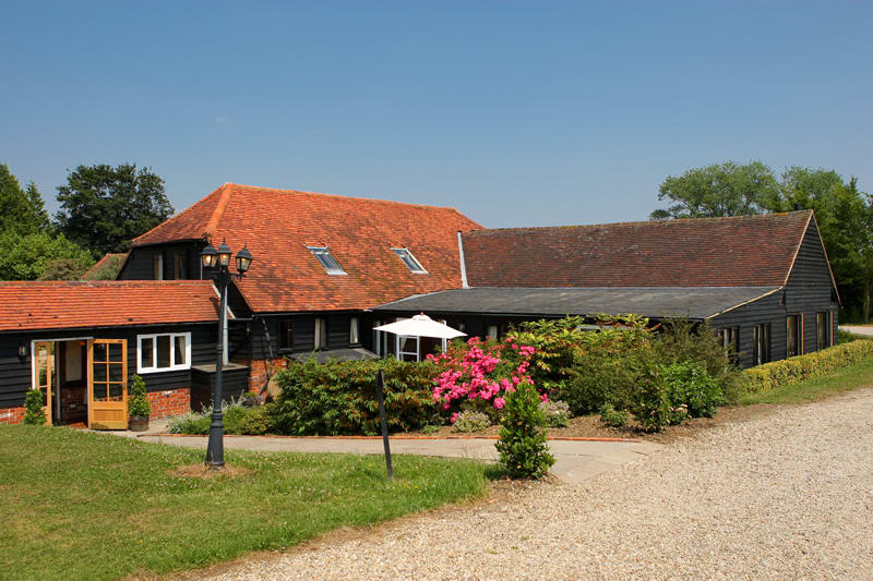 the reid rooms on a sunny day, seen from the outside, a barn wedding venue in essex