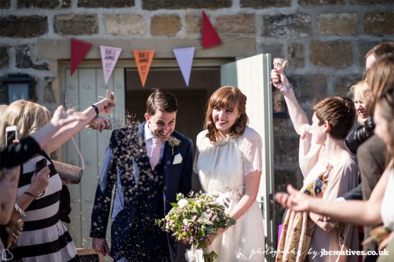 couple confetti shot outside of the Chilli Barn, a wedding venue in yorkshire