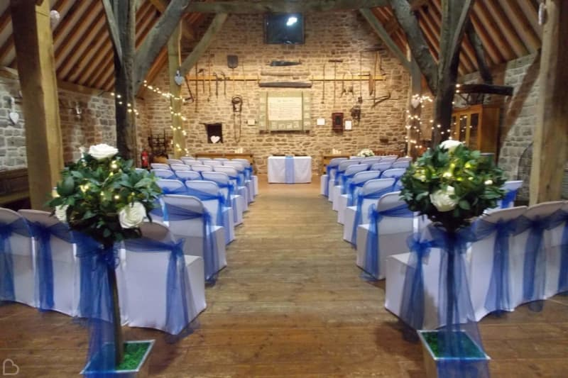 manorial barn set up for a wedding ceremony