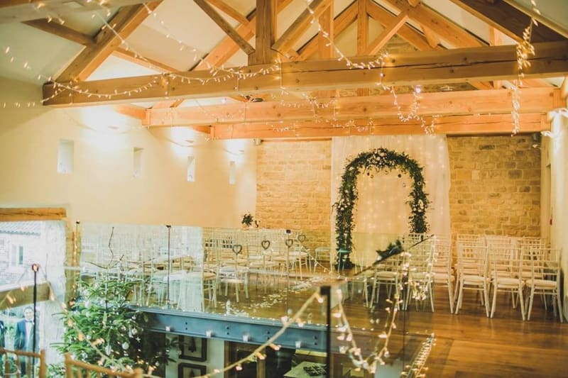 priory cottages interior decorated with fairy lights and greenery for a christmas wedding