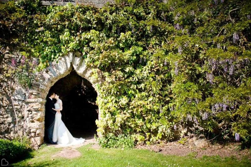 a married couple kisses in berkeley castle