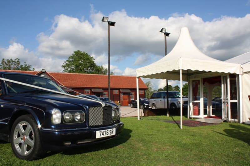 a car is parked outside stables lodge wedding venue