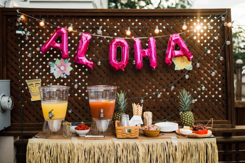 Hawaiian Luau engagement party with Hawaiian food and drinks displayed on table