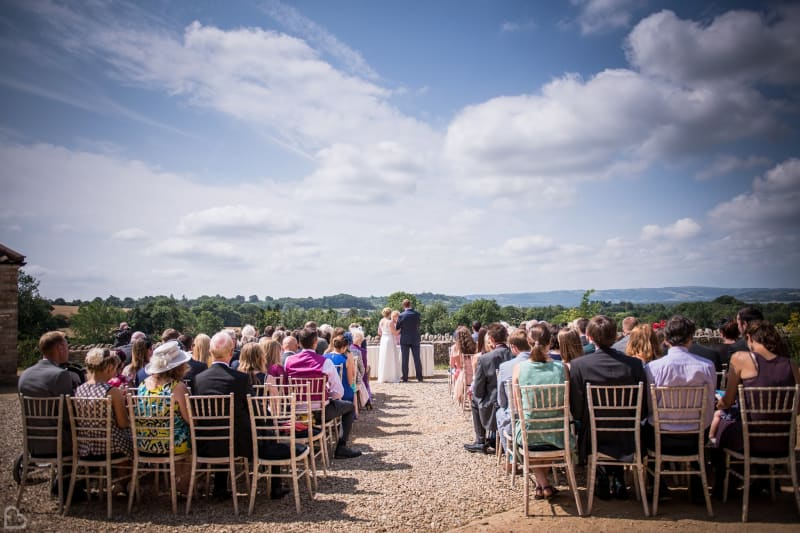 outdoor wedding ceremony going on at folly farm wedding venue
