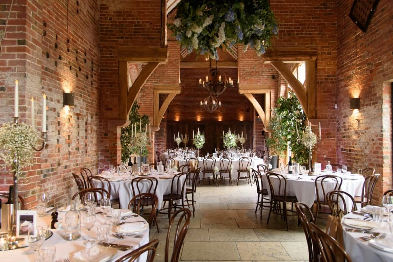 wedding dinner set up at shustoke farm barns in the uk