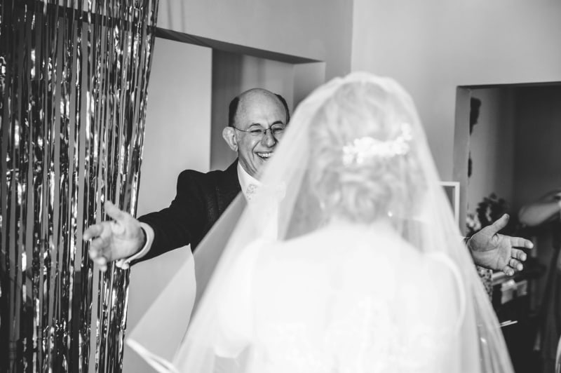 Faye's father about to hug her on her wedding day