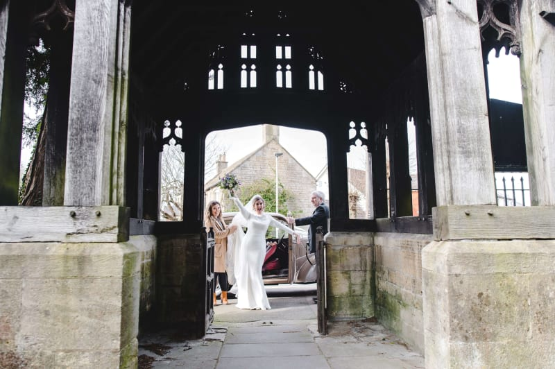 Faye Hughes stepping out of her wedding car ready to get married
