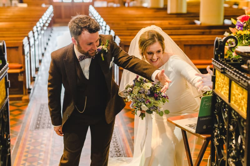 Faye and Adam Hughes in the church getting married