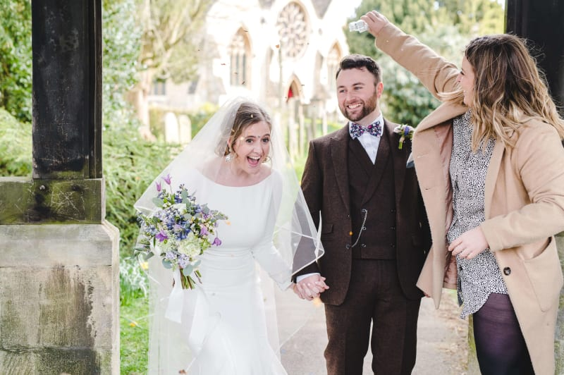 Adam and Faye Hughes holding hands on their wedding day