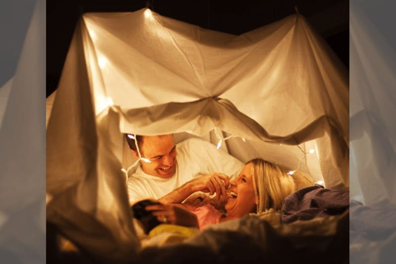 couple in tent with fairylights
