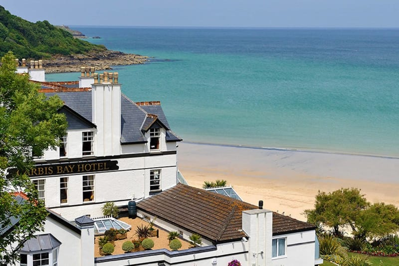carbis bay hotel on a overlooking the sea on a beautiful sunny day