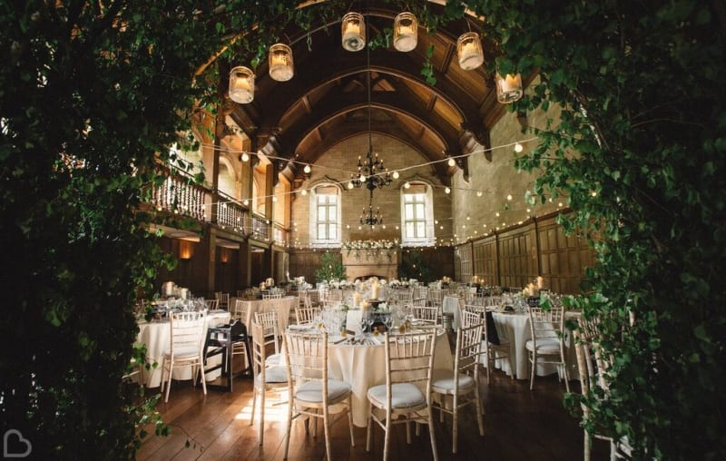 Beautiful barn wedding venue with tables and chairs set up