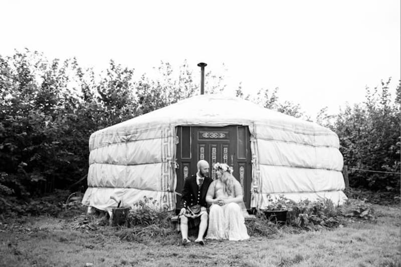 Bride and groom sit outside Plan-It Earth, a small wedding venue in the uk