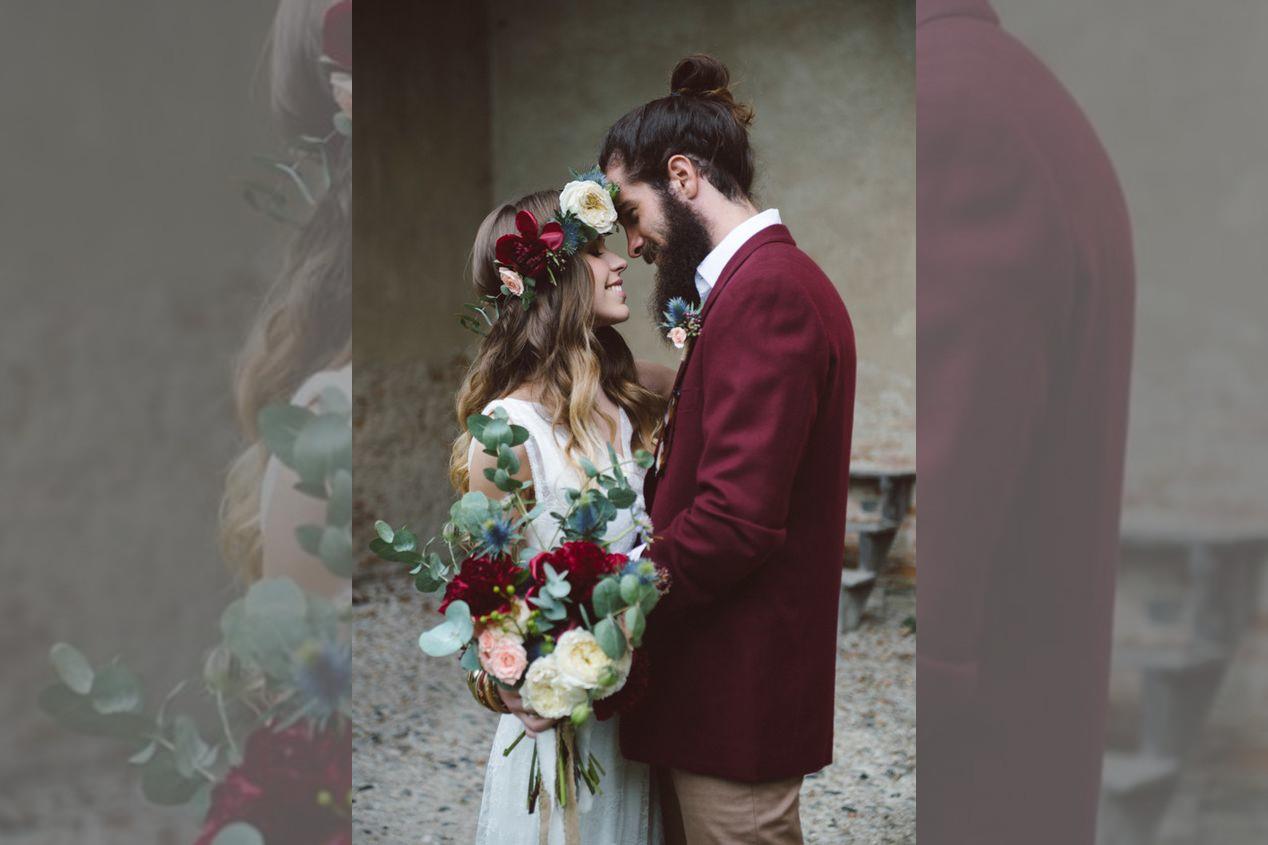 bridebook.co.uk-flower crown bride and groom embrace