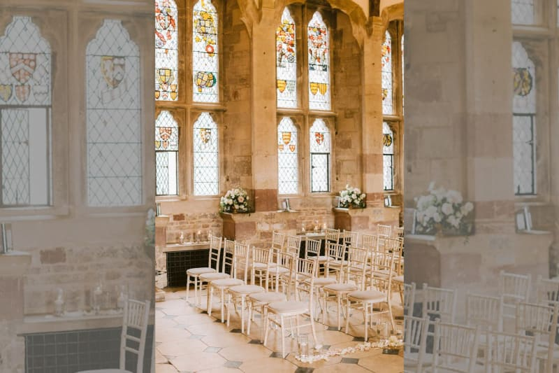 The ceremony room with historic looking windows.