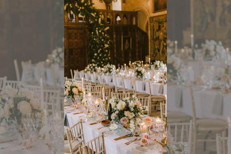 Tables set inside ready for for dinner.