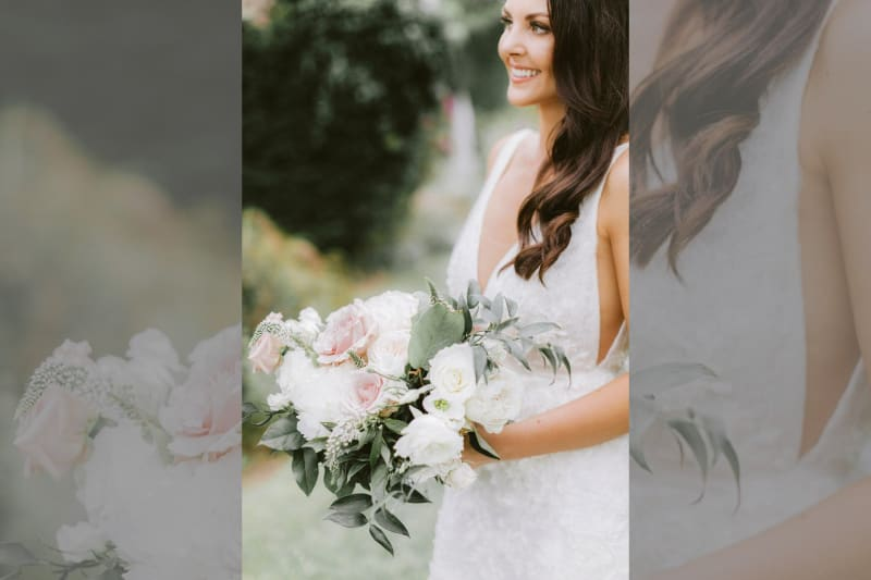 A close up of the flower bouquet being held by the bride.
