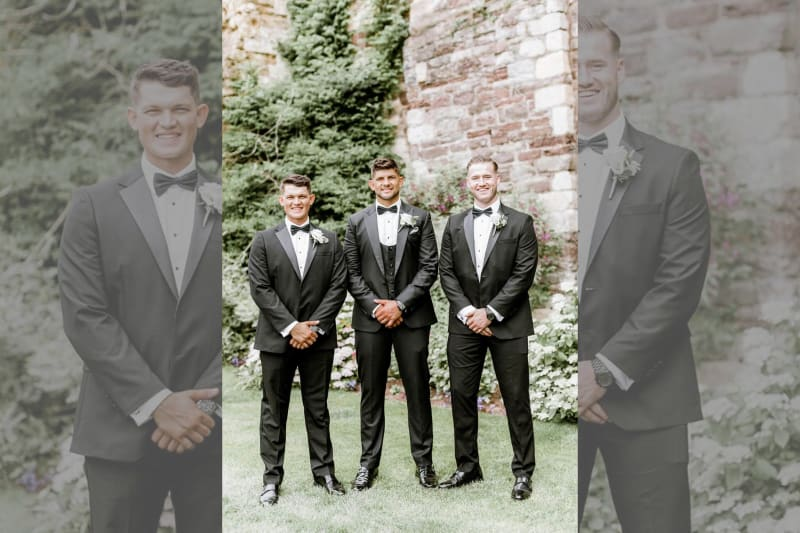 The groom and two groomsmen posing for a photo.