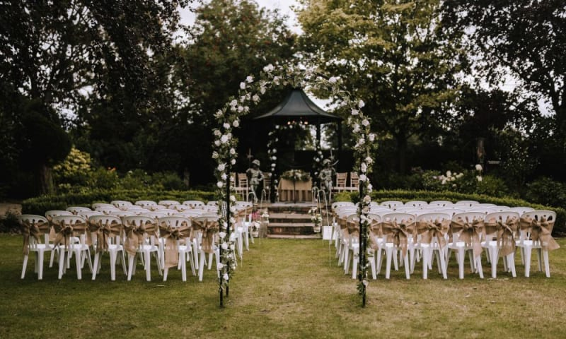 The garden gazebo is set for the civil ceremony outside.