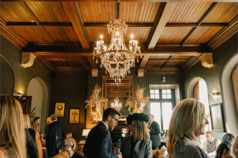 The guest inside the building, which features a chandelier hanging from a wooden ceiling.