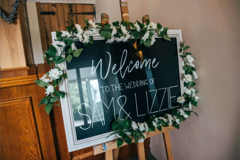 A sign that reads (Welcome to the wedding of Sam & Lizzie).