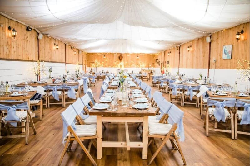 The dinner room made of wood decorated in blue.