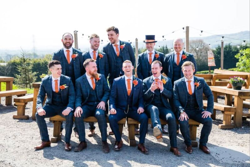 The groom posing with his groomsmen.