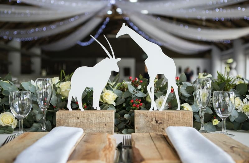 Woodland animals on seats at wedding with woodland animal wedding theme