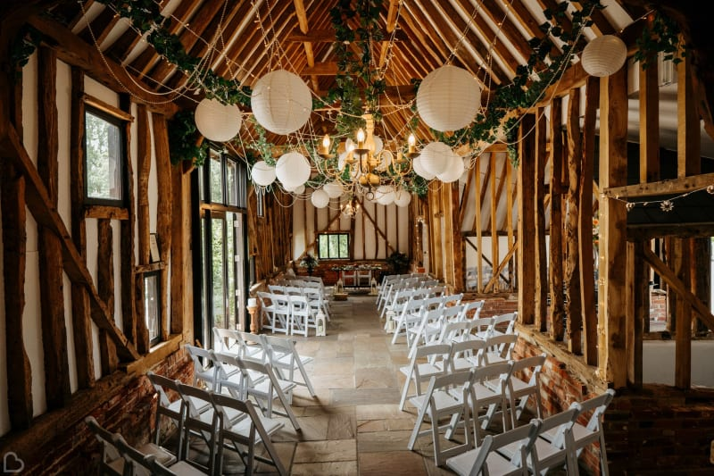 Beautifully decorated barn, ready for an intimate wedding ceremony at High House Weddings.