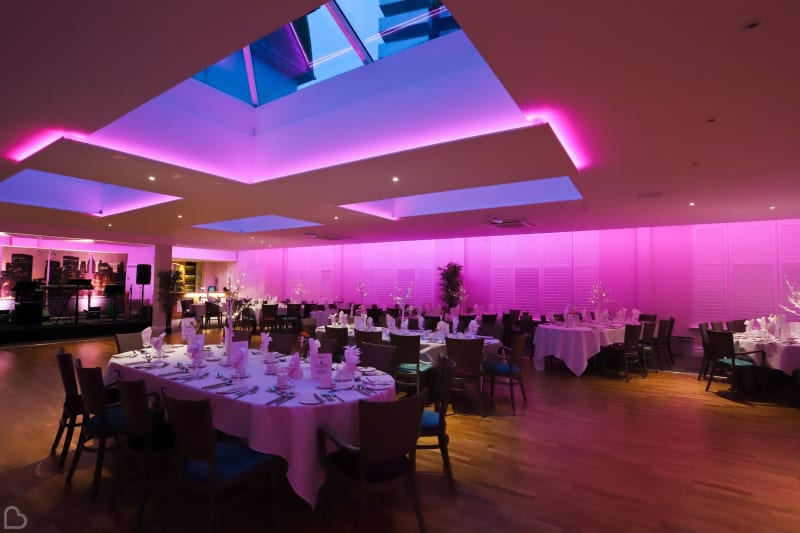Dining room at the Marsham Court Hotel, with pink and purple lighting and a skylight.