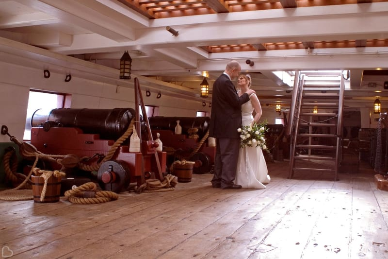 Newlyweds inside a ship at the National Museum of the Royal Navy.