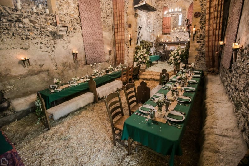 Two tables set up for an intimate wedding dinner in The Lost Village of Dode