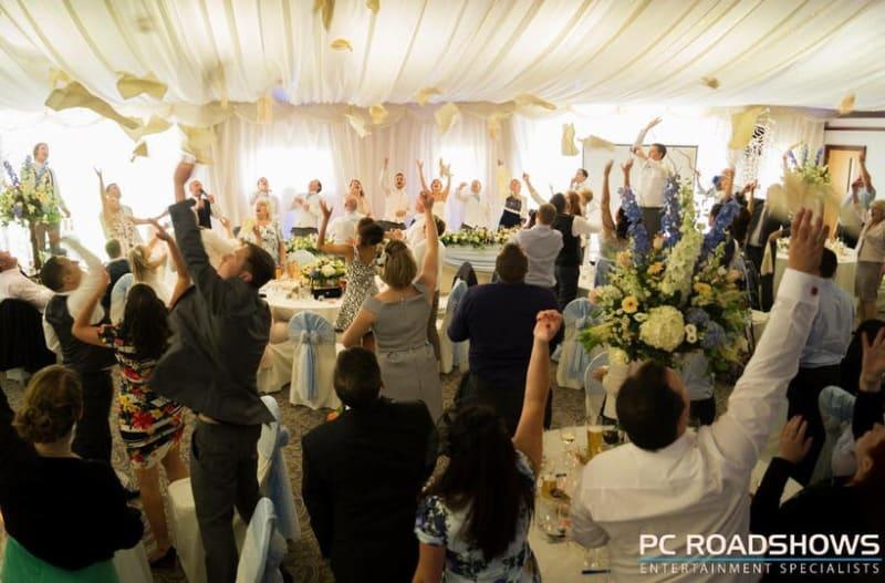 Many people celebrating and having fun at wedding ceremany