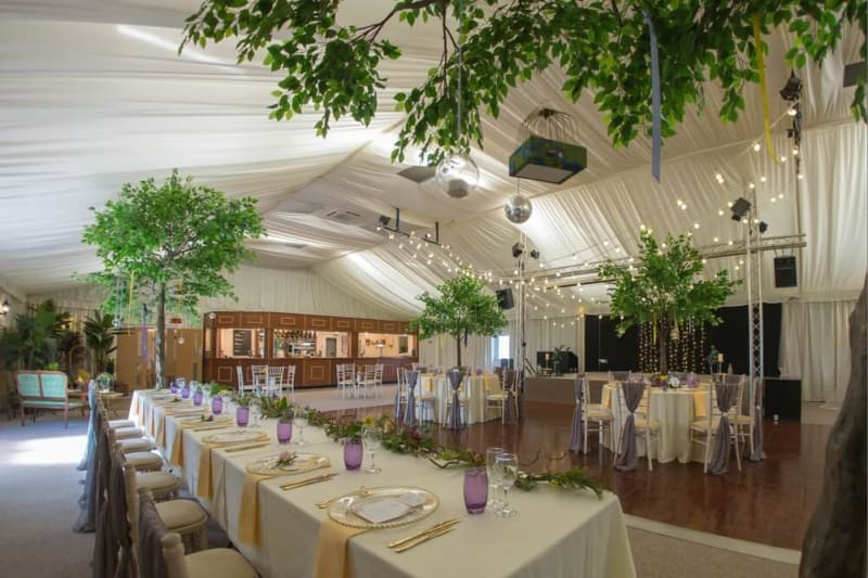 The interior of the venue decorated for a wedding.