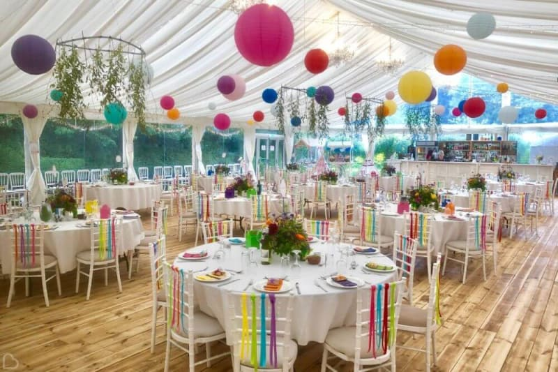 The interior of the big tent decorated in colorful colors.