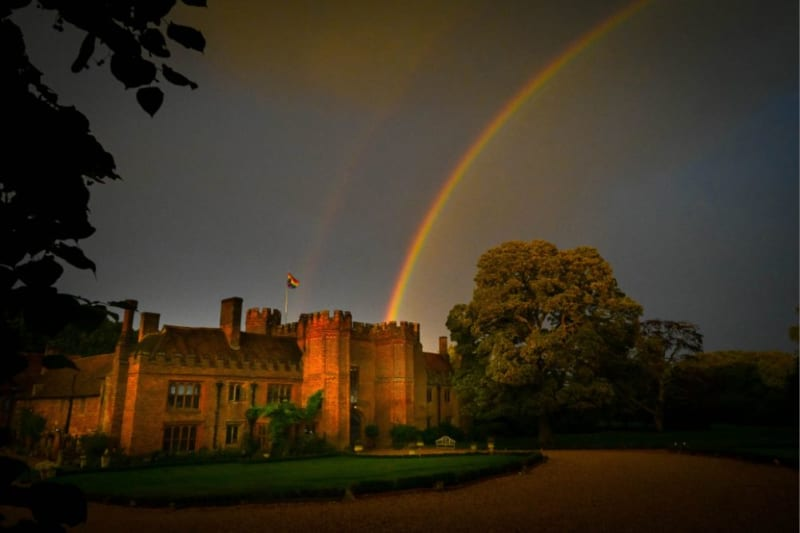 A rainbow is shown across the sky, which appears to end in the manor.