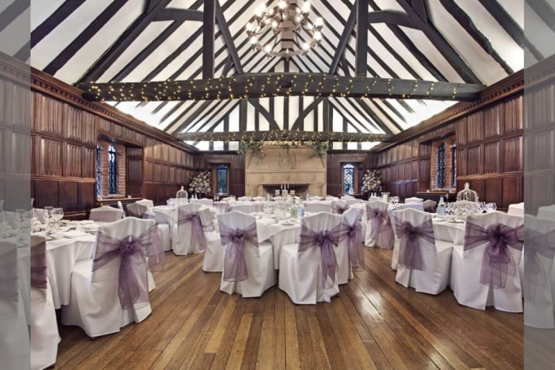 Inside the building, a reception room decorated in white and purple.