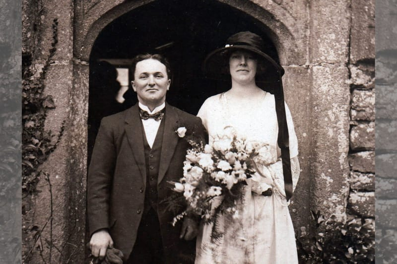 A black and white picture of a newlywed couple.