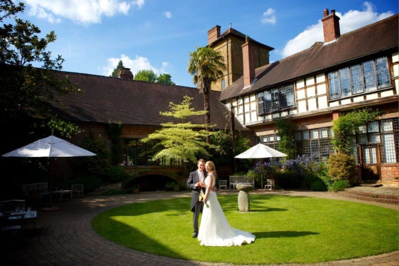Bride and Groom embrace in the lawn outside the house.