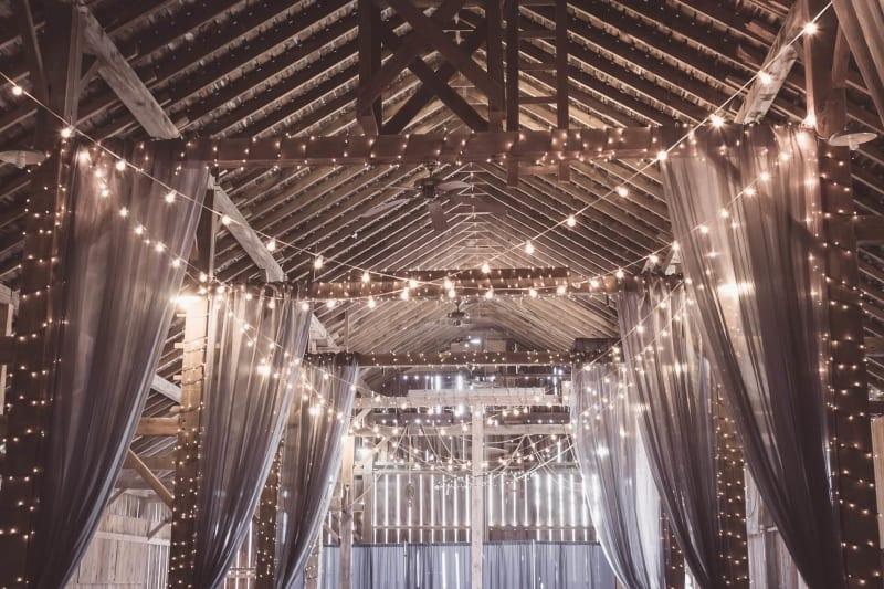 Wedding fairy lights decoration in beautiful barn wedding venue