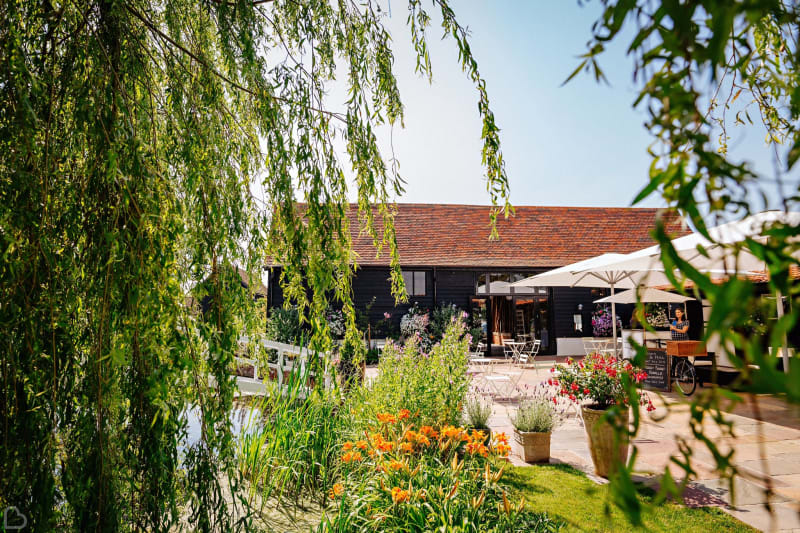 Beautiful and sunny essex wedding venue, covered in spring flowers.