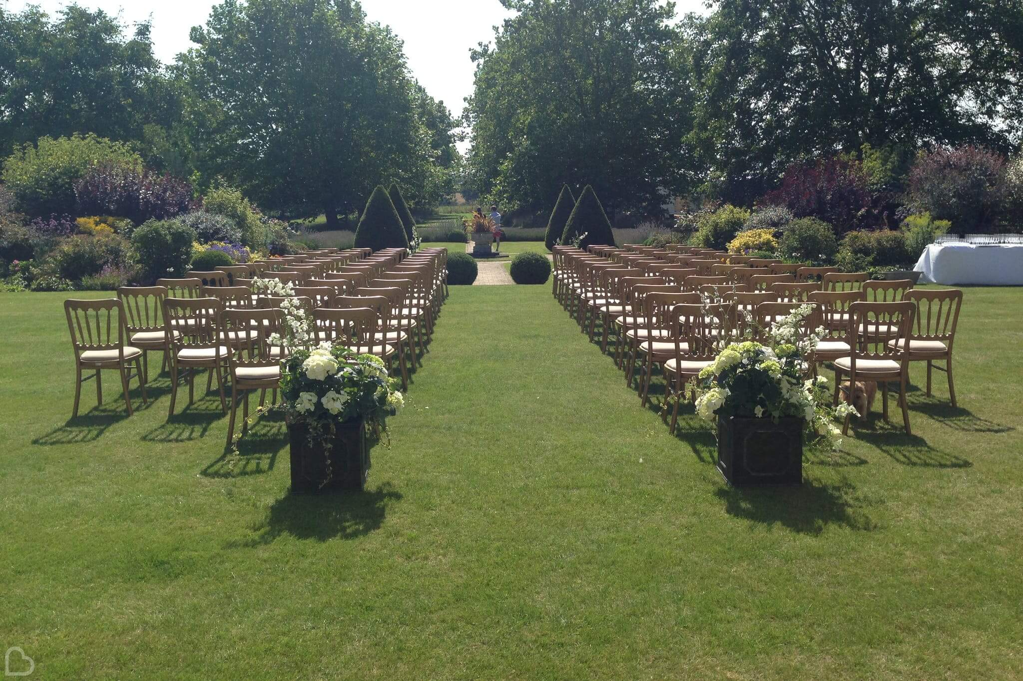 Outdoor wedding ceremony set up at hockering house in norfolk.