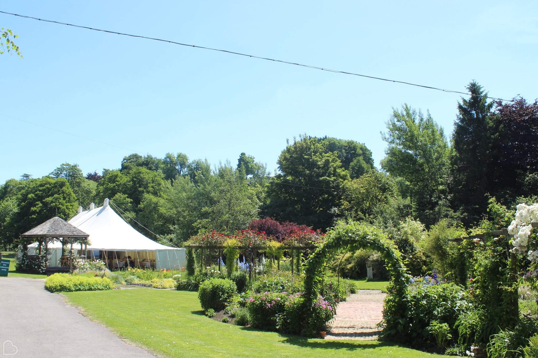Beautiful wedding venue on a beautiful sunny day. Gants Mill & Garden is set up with marquees and a nicely kept garden.