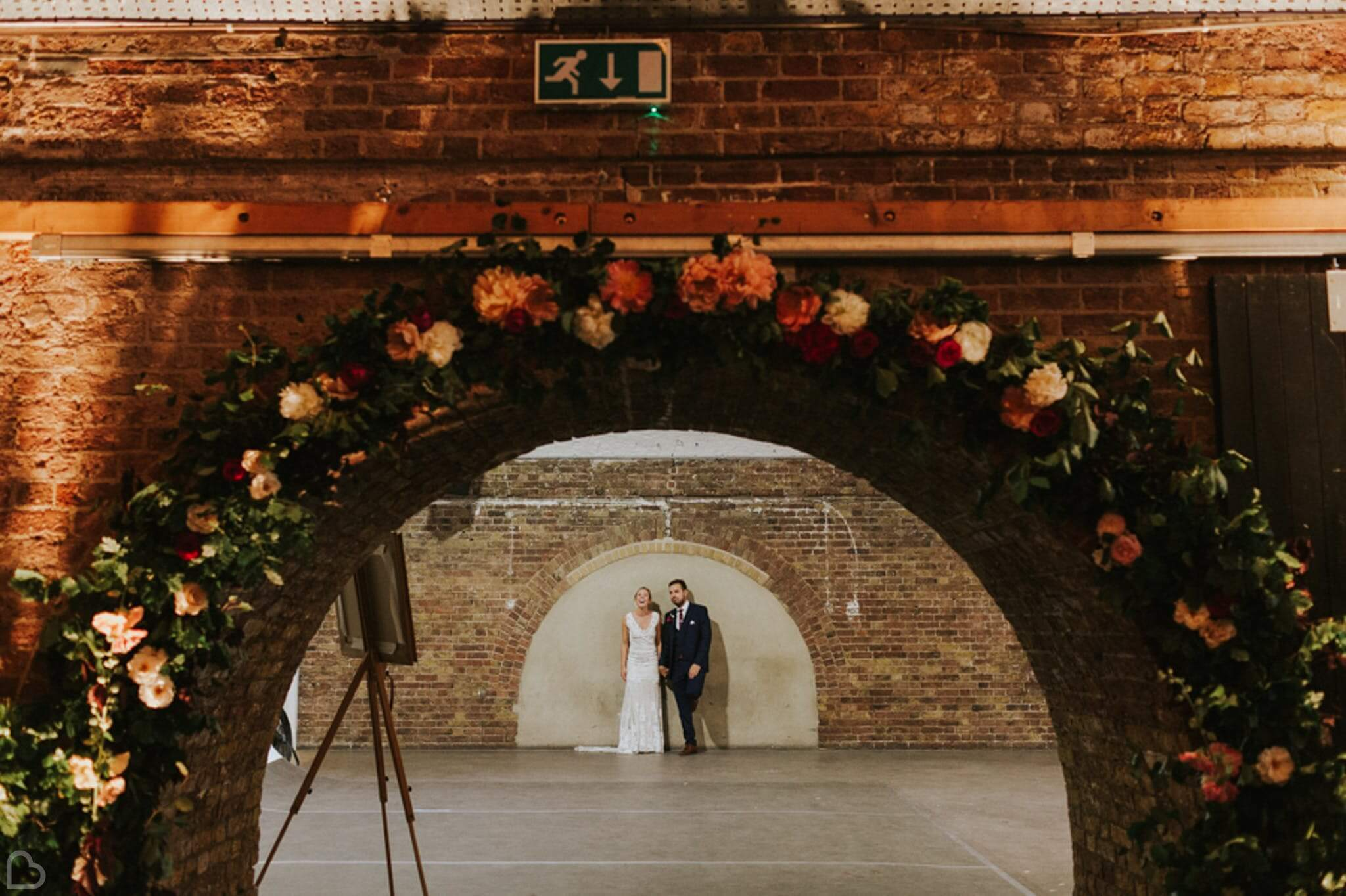Bride and groom looking cheerful in their wedding venue, Shoreditch Studios.